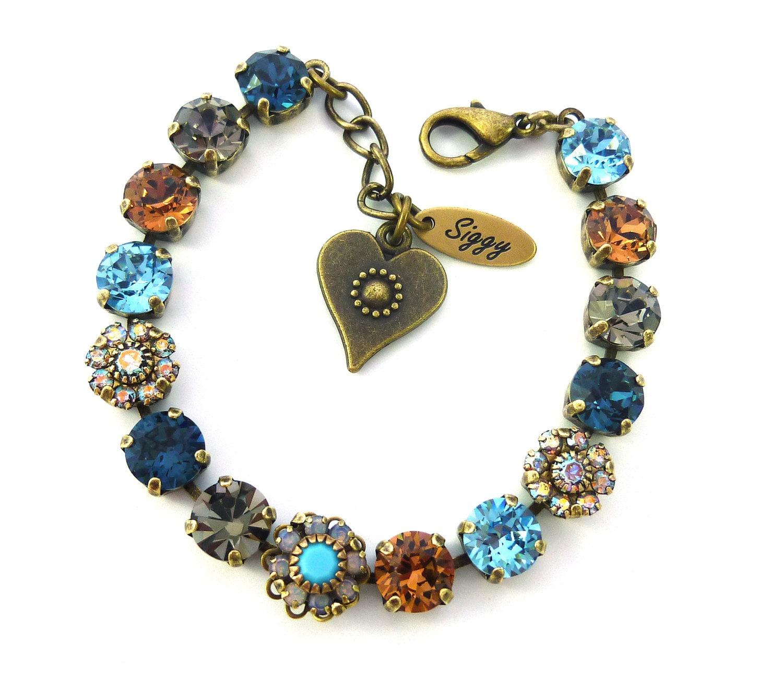 swarovski crystal tennis bracelet topaz blue flower. Black Bedroom Furniture Sets. Home Design Ideas