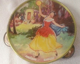 Child's tin tambourine SALE with a image of a dancing lady