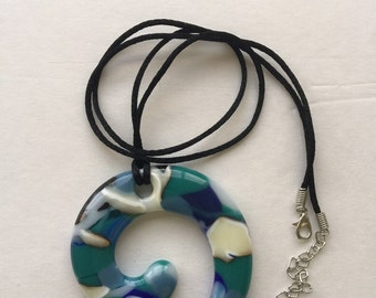 Blues, white and creme in a journey shape fused glass pendant