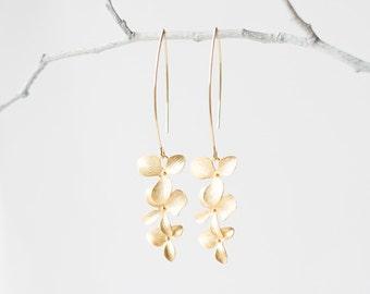 Delicate gold triple orchid flower earrings