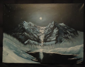 Moon at night over the mountains