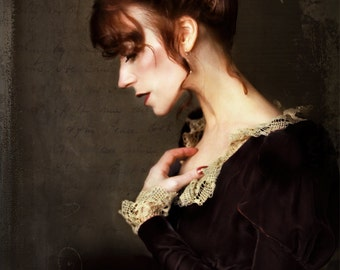 My Calmed Heart is a photographic portrait print of a woman with her hand resting against her heart in a moment of quiet peace