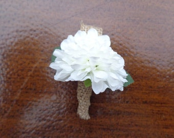 Ring bearer boutonniere designed with a mini white mum