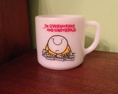 """Vintage Federal Glass Co. Ziggy White Milk Glass Mug """"I'm Overworked and Underpaid"""" 1974"""