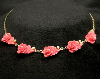 Carved Roses Coral Celluloid Necklace