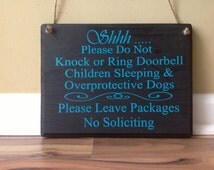 Shhh Please do not knock or ring doorbell Children sleeping overprotective dogs Please leave packages No Soliciting door sign hanger black