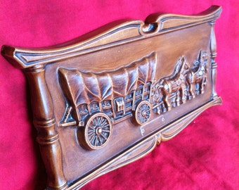 A Chalkware Plasterware Wall Plaque With A Wagon And A Team Of Horses