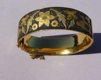 A Vintage Damascene black and gold cuff bangle bracelet