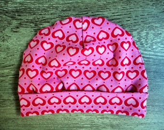 Baby hat with hearts