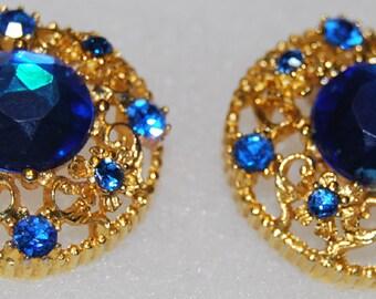 signed selini earrings