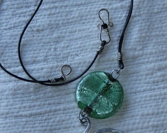 Pendant with an Indian glass bead and spiral from a hammered aluminium wire