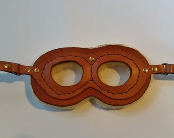 Tan leather aviator goggles