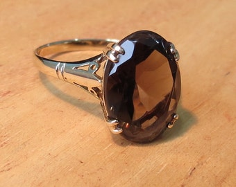 A vintage 9k yellow gold ring with a large smoky quartz gemstone