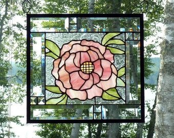Stained glass showing off a beautiful pink peony giving you the taste of summer all year around