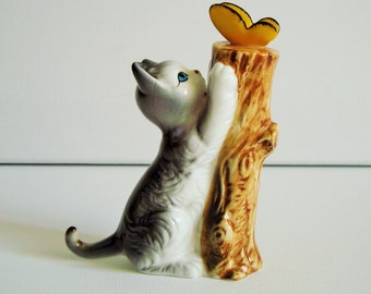 Vintage striped tabby kitty cat playing with butterfly ornament