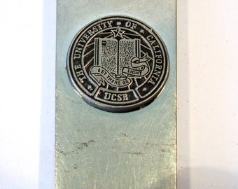 University of California Santa Barbara chrome clad letter opener. Let There Be Light, art deco design elements, UCSB, home office tool