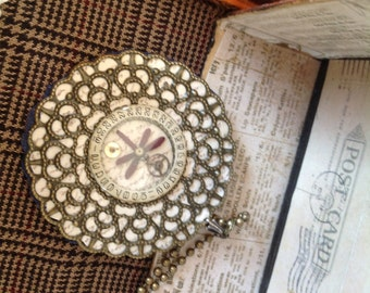 Steampunk;victorian;necklace;brooch;filigree;mixed media;collage;repurposed;recycled;gears;wings