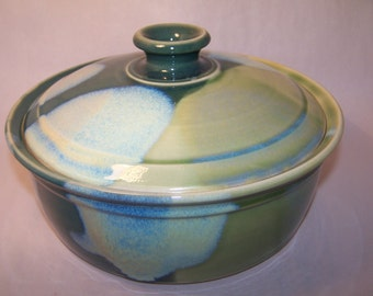 Casserole, Glazed in green tones . diameter 24cm.Height without lid  9cm. capacity 2 litres.