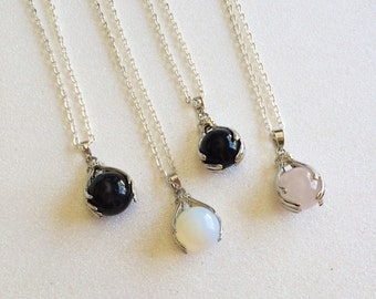 Crystal Ball in Hands Quartz Necklace