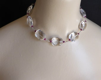 Elegant facetted clear crystal quartz necklace with ruby