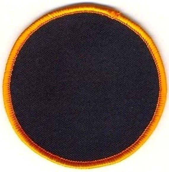 Blank embroidered patch round black background by heygidday