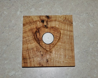 Raised heart tealight holder