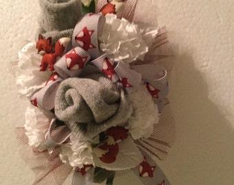 Fox baby sock corsage