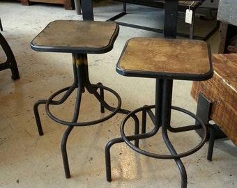 A Pair Of Vintage Industrial Stools