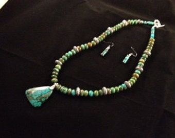 Real turquoise beads and pendant with silver beads, clasp and earrings.