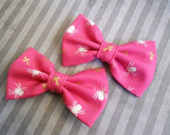 pink with spiders and crosses hair bow set