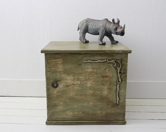 Olive green locker in shabby chic style