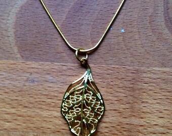 Gold filigree leaf necklace