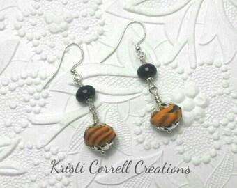Pretty black onyx and orange glass bead earrings. Black and orange earrings. Orange and black earrings. Black earrings. Orange earrings.