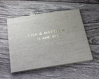 Personalised natural oatmeal linen guest book – fully bound A4 landscape (29.7cm x 21cm)