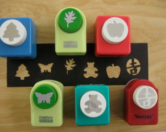 """6 shape paper punches (tree, butterfly,leaf,bear apple, """"good luck"""" symbol)"""