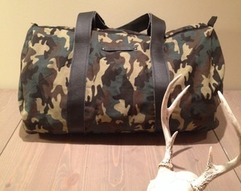 Camo duffel bag with black leather straps