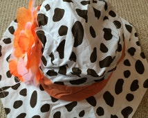White and Brown Giraffe Print/Cow Print/Animal Print Sun Hat/Bucket Hat with Wide Orange Stripe and Bright Orange and White Flower