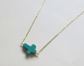 Blue Cross necklace in gold
