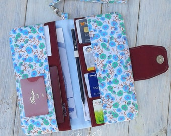Floral Travel wallet for women with wristlet strap in blue and marsala colors