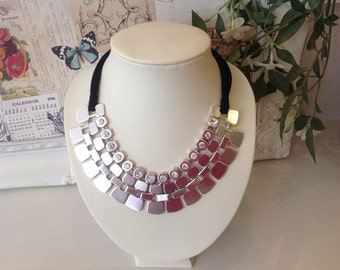 Silver statement necklace with diamanté beads and black suede cords