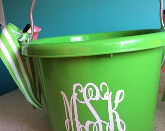 Lime green plastic bucket 2 gallon with 3 initials or name.