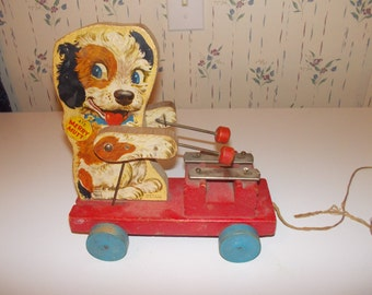 vintage fisher price merry mutt pull toy