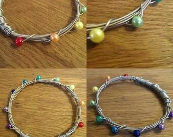 Rainbow guitar string bracelet.