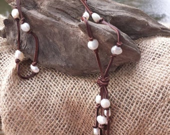 Fringed freshwater pearls galore on soft deerskin leather