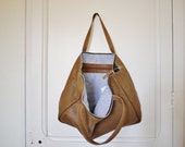 Nice light brown leather tote bag perfect for every day. Lined zipped tote bag