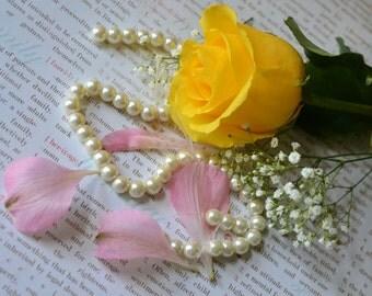 Yellow Rose and pink petals
