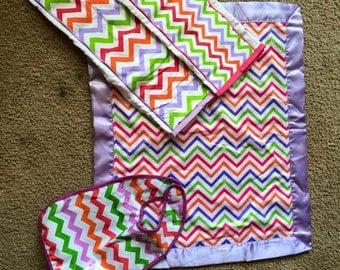 baby chevron blanket, 2 burb clothes, and a bib