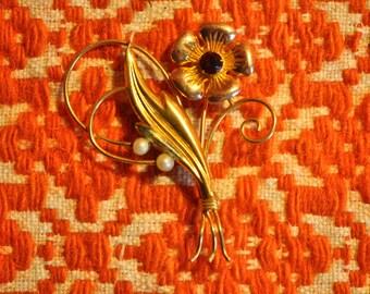 golden flower brooch