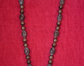 1950 s long brown glass bead necklace.