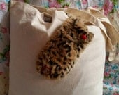 A leopard print fluffy mitten pocket on a canvas economy bag for life.  Reworked and upcycled.hand sewn.